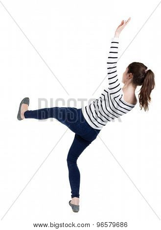 Balancing young woman.  or dodge falling woman. Rear view people collection.  backside view of person.  Isolated over white background. Frenchwoman in vest falls on his back slipping.