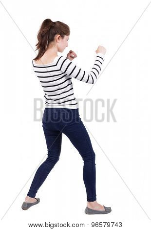 skinny woman funny fights waving his arms and legs. Isolated over white background. Frenchwoman in vest standing in a boxing pose.