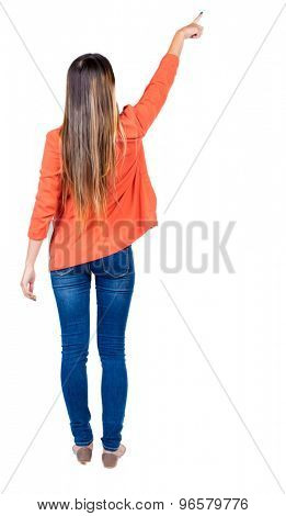 Back view of  pointing woman. beautiful girl. Rear view people collection.  backside view of person.  Isolated over white background. The girl in the red jacket is pointing index finger up and right.