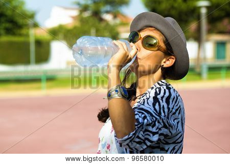 Woman Dressed In Retro Shape While Drinking Water