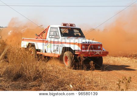 Drifting White Toyota Landcruiser Truck Kicking Up Dust On Turn Ar Rally
