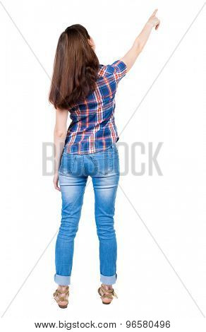 Back view of  pointing woman. beautiful girl. Rear view people collection.  backside view of person.  A young girl in a checkered blue shirt shows a finger of his right hand up.