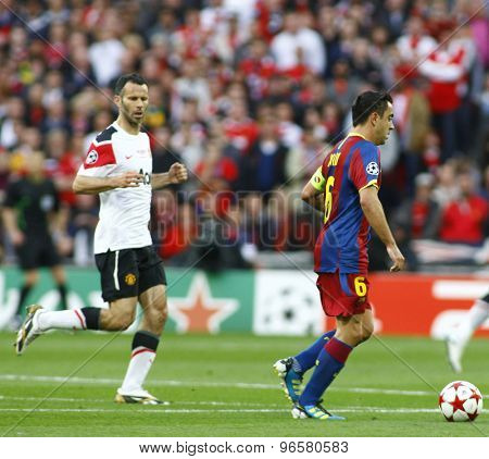 LONDON, ENGLAND. May 28 2011: Manchester's midfielder Ryan Giggs and Barcelona's midfielder Xavi Hernandez  during the 2011UEFA Champions League final between Manchester United and FC Barcelona