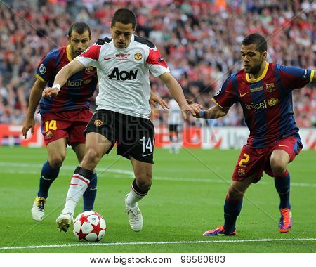 LONDON, ENGLAND. May 28 2011: Javier Mascherano, Manchester's forward Javier Hernandez and Daniel Alves during the 2011UEFA Champions League final between Manchester United and FC Barcelona