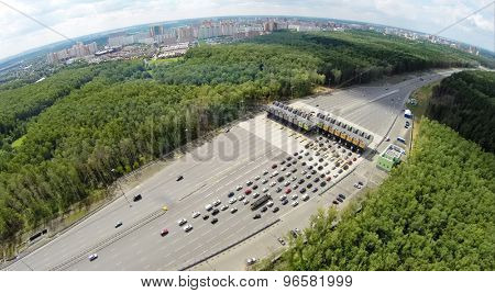 RUSSIA, MOSCOW - JUL 5, 2014: Cityscape with traffic on road at summer day. Aerial view. Photo with noise from action camera. Photo with noise from action camera