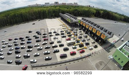 RUSSIA, MOSCOW - JUL 5, 2014: Car traffic near fee. Aerial view. Photo with noise from action camera. Photo with noise from action camera