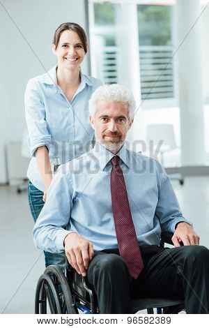 Woman Pushing A Man In Wheelchair