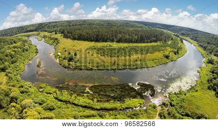 RUSSIA, NICOLA-LENIVETS - JUL 6, 2014: River shore in Wonderland Park during 9th Festival of landscape objects Archstoyanie. Aerial view. Photo with noise from action camera.