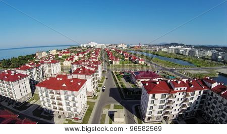 RUSSIA, SOCHI - JUL 30, 2014: Town-hotel Barhatnye Sezony near ponds and Fisht olimpic stadium. Aerial view. Photo with noise from action camera.