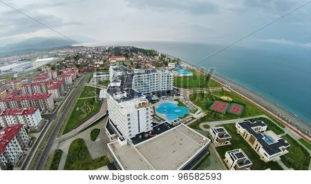 RUSSIA, SOCHI - JUL 26, 2014: Town-hotel Barhatnye Sezony and hotel Radisson Blu at summer evening. Aerial view. Photo with noise from action camera.