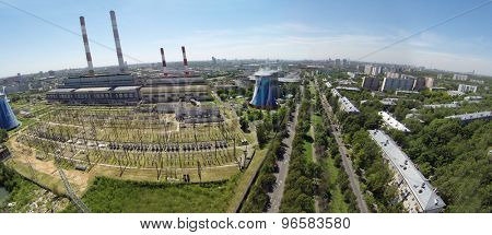 RUSSIA, MOSCOW - JUL 14, 2014: Electric power station in city. Aerial view. Photo with noise from action camera.
