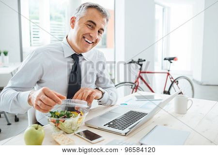 Businessman Opening His Salad Pack