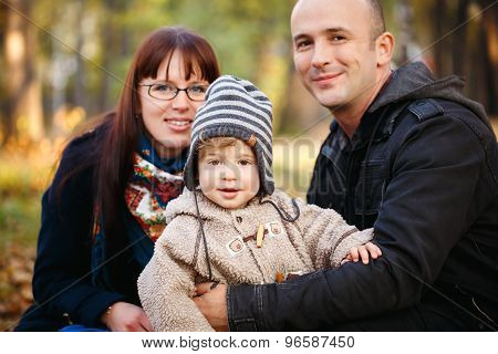 Happy Family Resting In The Park