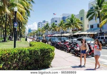 Ocean dr. street in south Miami in daylight with people and cars on a background