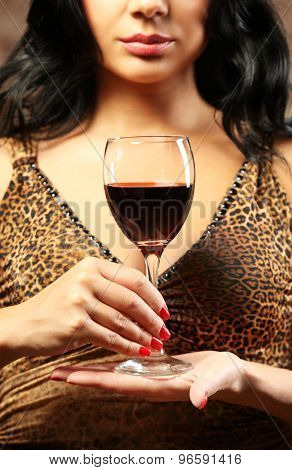 Pretty young woman with wineglass, closeup