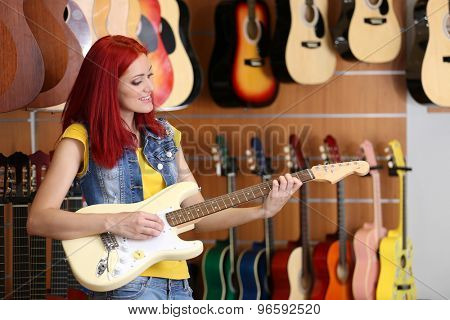 Beautiful young woman in music store