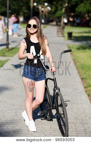 Beautiful girl with bicycle, outdoors
