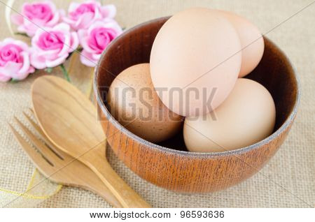 Eggs In Wooden Cup And Wooden Spoon.