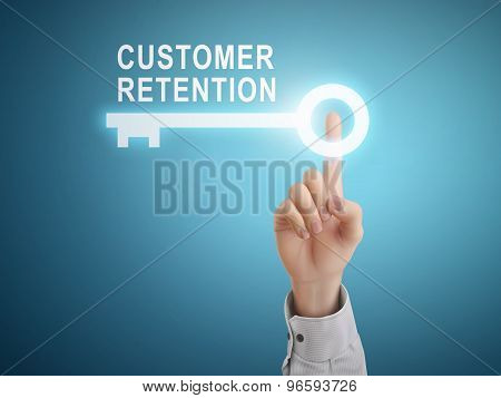 Male Hand Pressing Customer Retention Key Button