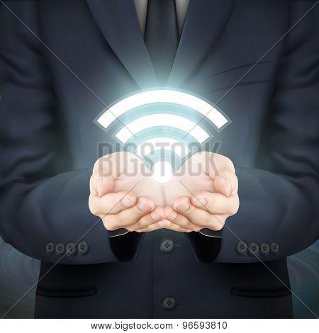 Businessman Holding Illuminated Wifi Icon