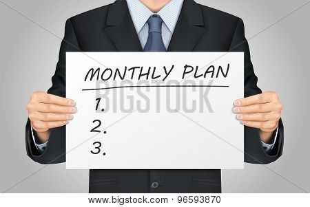 Businessman Holding Monthly Plan Words Poster
