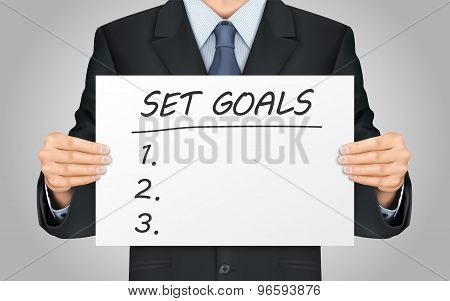 Businessman Holding Set Goals Poster