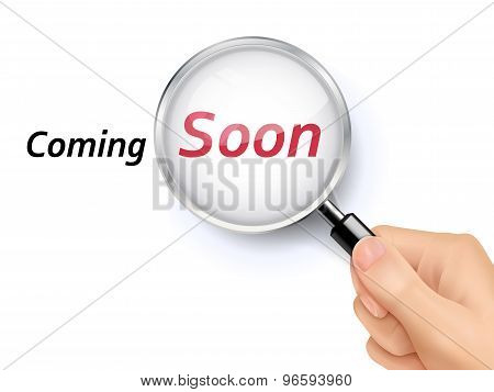 Coming Soon Showing Through Magnifying Glass
