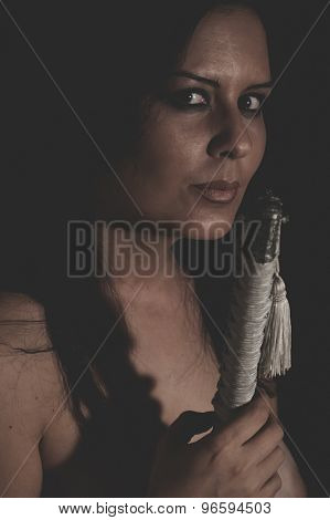 War, warrior wild woman with black hair and iron sword