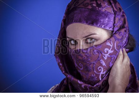 Islam, Beautiful arabic woman with traditional veil on her face, intense look