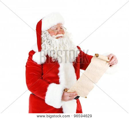 Santa Claus holding wish list, isolated on white background