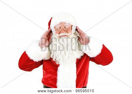 Santa Claus with headphones listening to music, isolated on white background