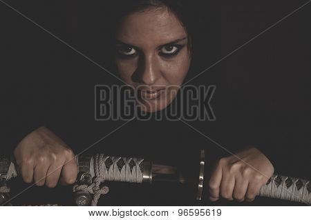 warrior wild woman with black hair and iron sword