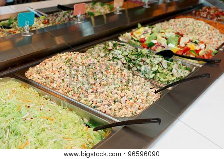 Various salads in gastronomical containers, food store