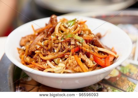 Noodles with soy sprouts and vegetables cooked in wok, typical asian food