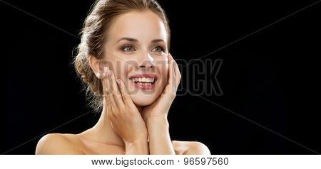people, emotions and expressions concept - happy excited woman face over black background