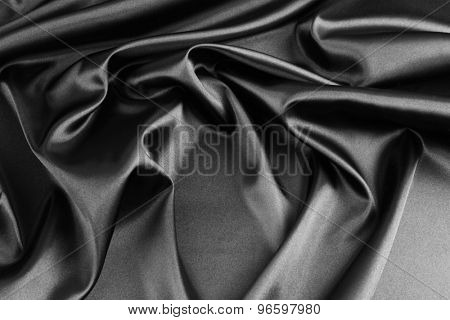 Closeup of rippled black silk fabric