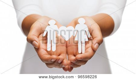 relationships and love concept - womans hands showing couple with heart shape