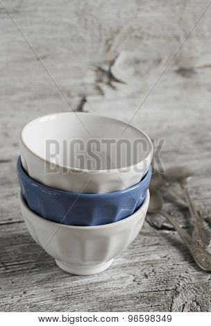 Ceramic Bowls, Dishes In Vintage Style On A Light Wooden Background