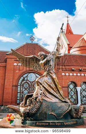 Statue of Archangel Michael with outstretched wings, thrusting s