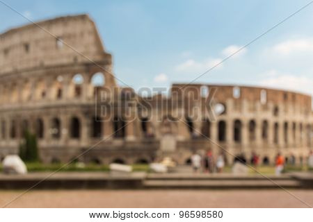 architecture, history and tourism concept - Colosseum in Rome blurred background