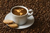 picture of continent  - Still life photography of hot coffee beverage with map of America continent - JPG