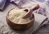 foto of quinoa  - White quinoa seeds on a wooden background - JPG