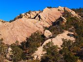 pic of punchbowl  - Rocky landscape with pine forests taken at Devils Punchbowl - JPG