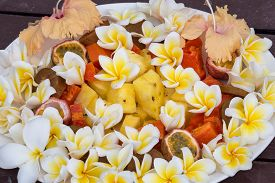 image of papaya fruit  - Fruit dessert salad with pineapple papaya passion fruit and white frangipani flower on the plate - JPG