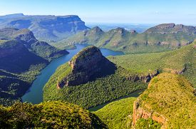 stock photo of three sisters  - Blyde River Canyon and The Three Rondavels (Three Sisters) in Mpumalanga South Africa. The Blyde River Canyon is the third largest canyon worldwide ** Note: Soft Focus at 100%, best at smaller sizes - JPG