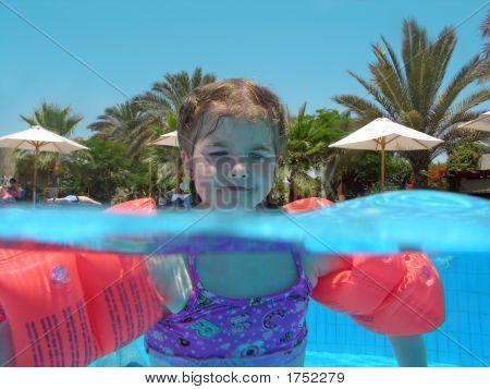 Child Swim In Pool