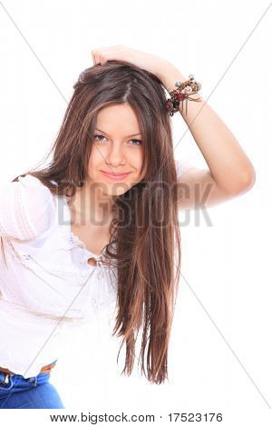 smiling young woman wearing a white shirt, studioshot over white background