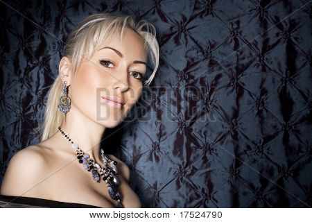 beautiful woman with jewelry. Space for text.