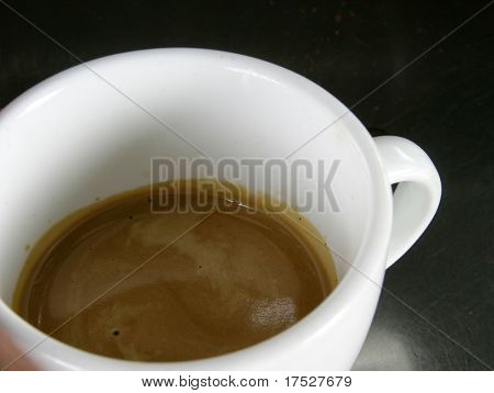 Double espresso in a white cup with nice crema