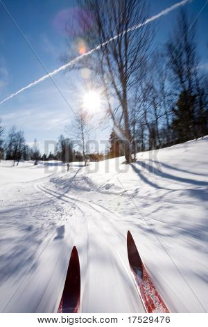 An action motion shot of cross country skiing